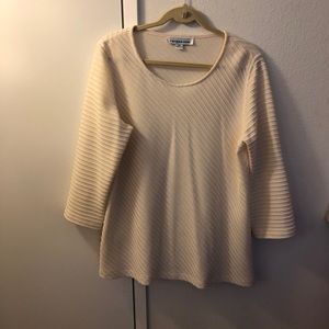 Tops - This is a 100% wool pull on women's shirt.